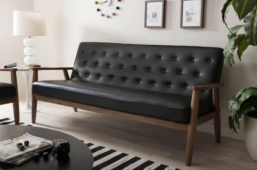 This is the Baxton Studio Sorrento 70.6 in Black Faux Leather 4-Seater Cabriole Sofa from Home Depot.