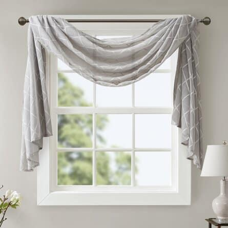 The Niord Solid Sheer Window Scarf by Charlton Home from Wayfair.