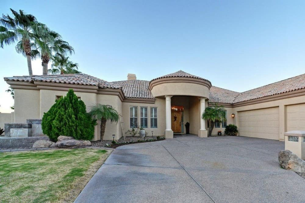 3-Bedroom Mediterranean Style Single-Story Ranch with Wet Bar and 3-Car Courtyard Entry Garage