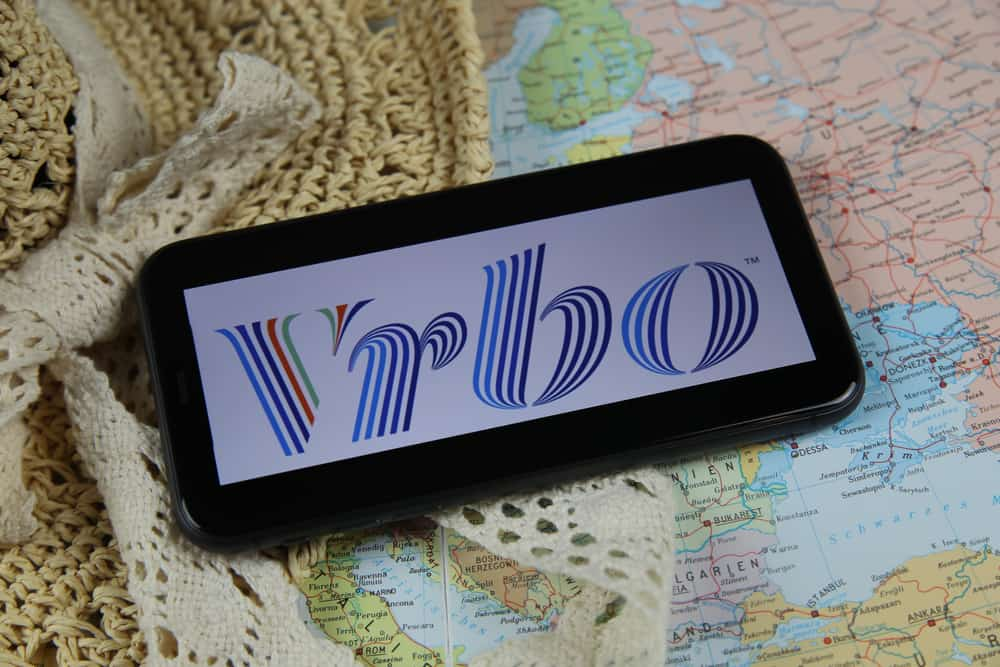 This is a mobile phone on a map showing the logo of VRBO.