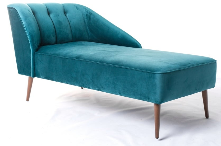This is a close look at a teal tufted and cushioned divan with wooden legs.