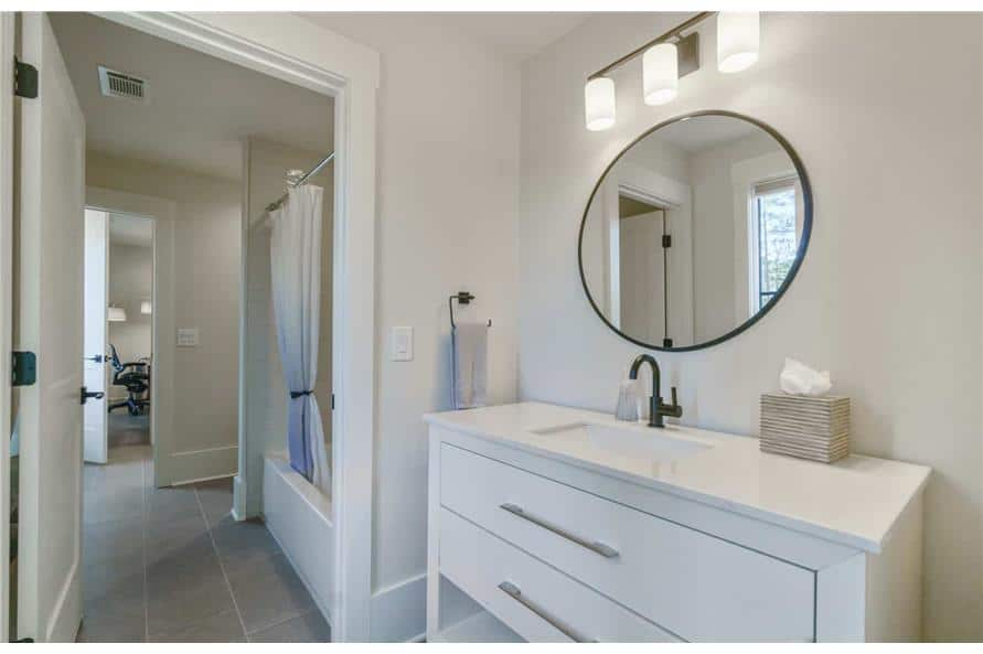 Bathroom with single sink vanity and a separate area for the tub and shower combo.