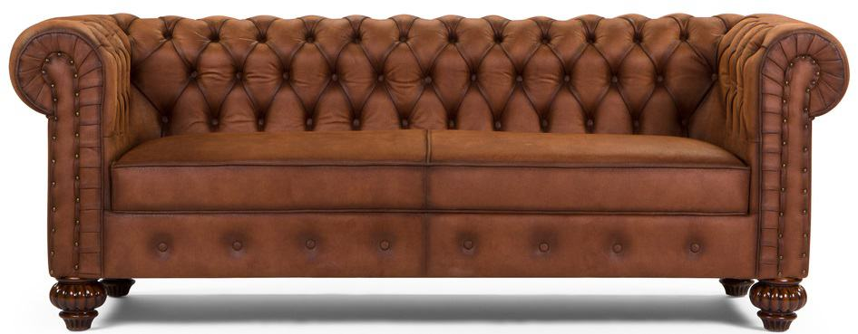 This is a close look at a brown leather chesterfield sofa.
