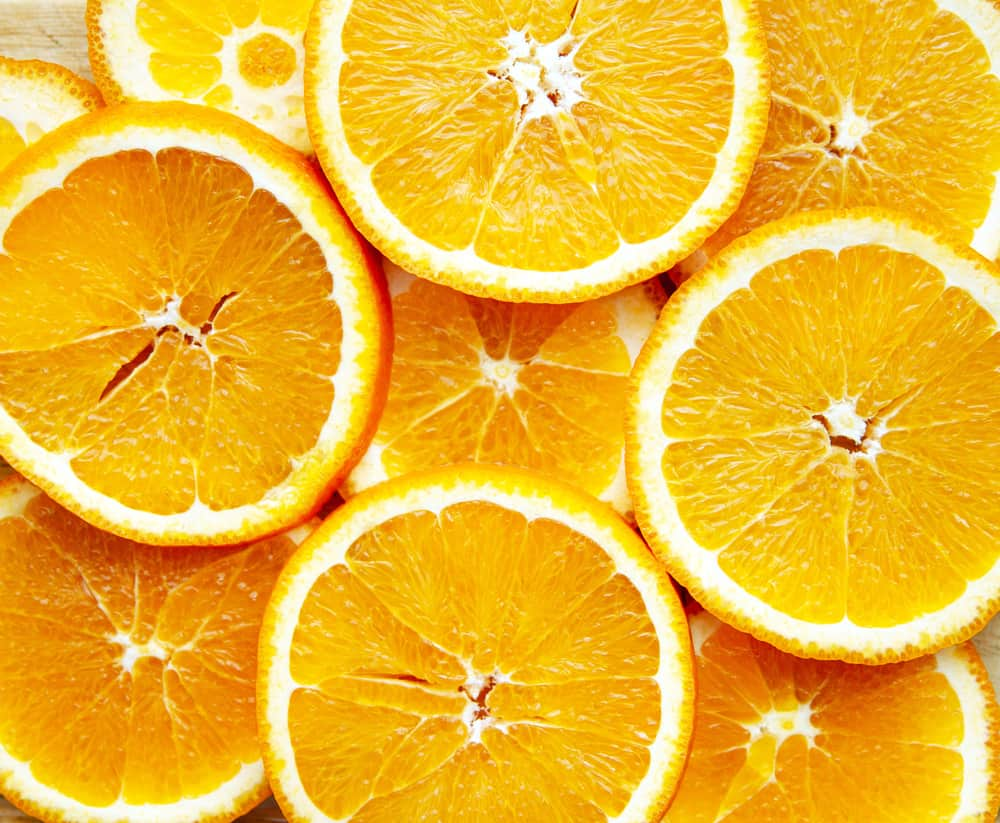 This is a close look at a bunch of thin orange slices.