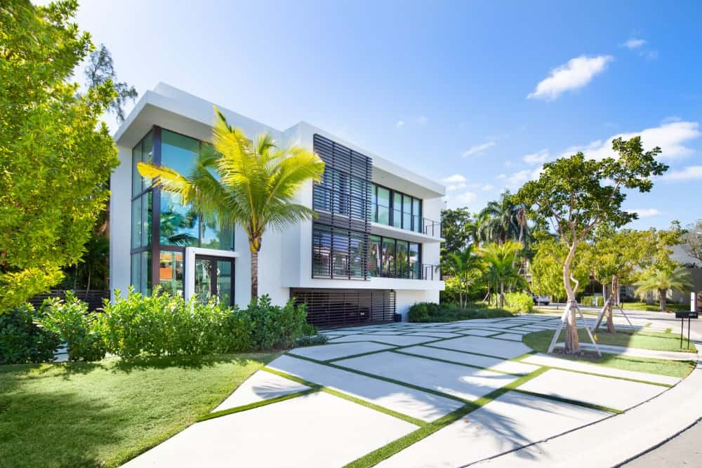 Hibiscus Island Home Offers 20-Ft Atrium, Massive Rooftop Terrace, and Floating Glass Staircase