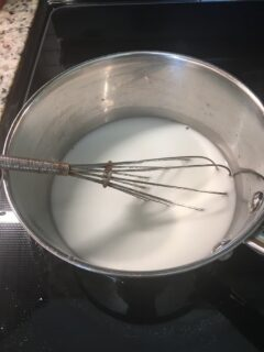 The cornstarch, water and sugar are cooked in a saucepan.