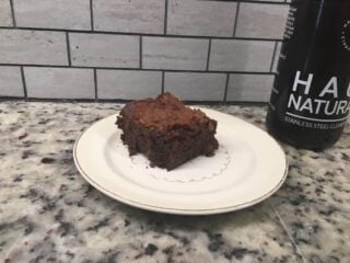 This is a slice of chocolate fudgy brownie on a plate.