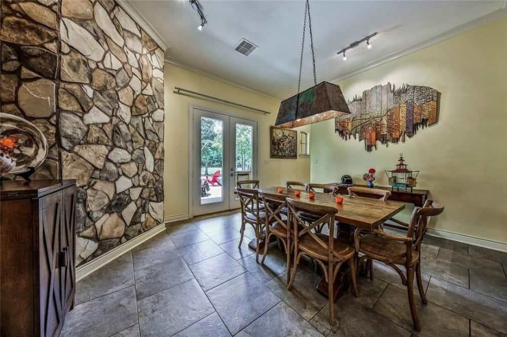 Breakfast area with an 8-seater dining set and a wooden buffet table graced with multi-panel wall art.