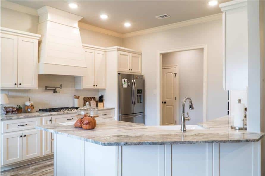 The kitchen includes an angled peninsula that serves as an eating bar perfect for casual meals.