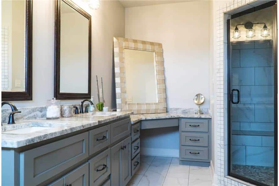 The primary bathroom features a corner shower and a dual sink vanity integrated with a make-up counter.