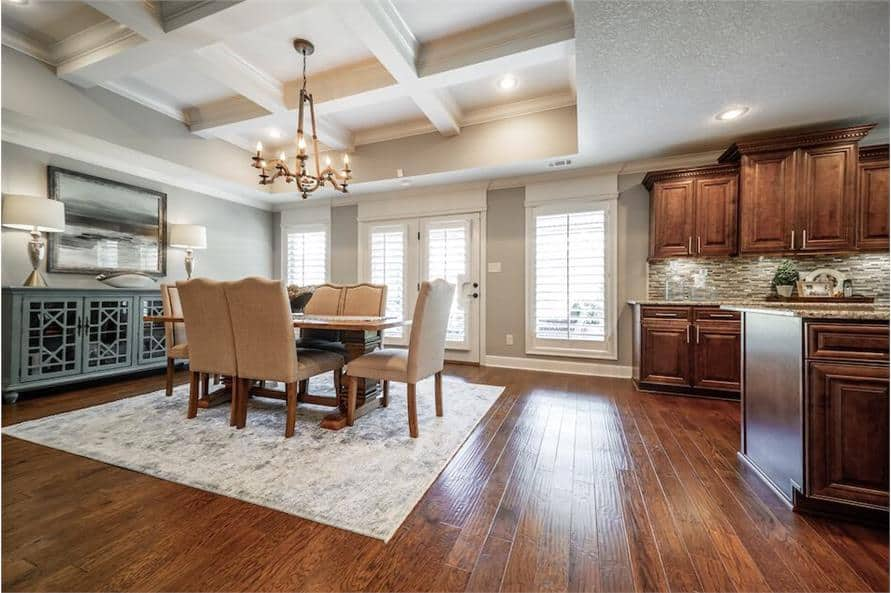 Across the kitchen is the dining area with a buffet table and a 6-seater dining set sitting on a distressed area rug.