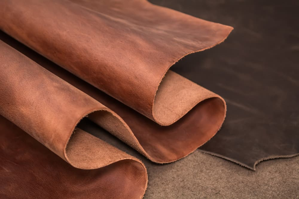 These are genuine real leather pieces with two brown tones.