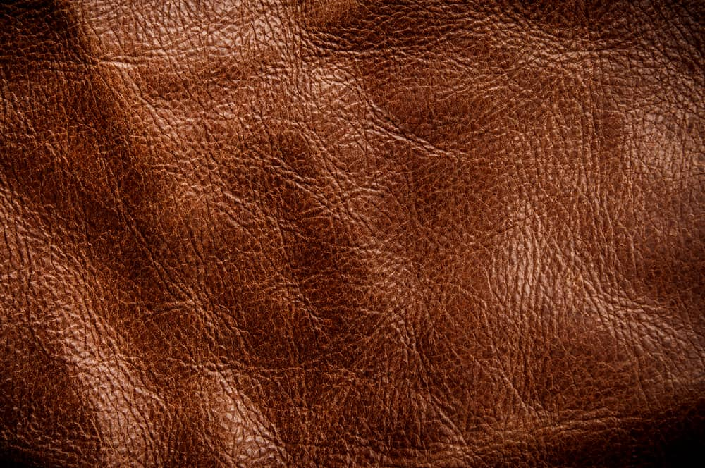 This is a close look at a dark brown genuine leather.