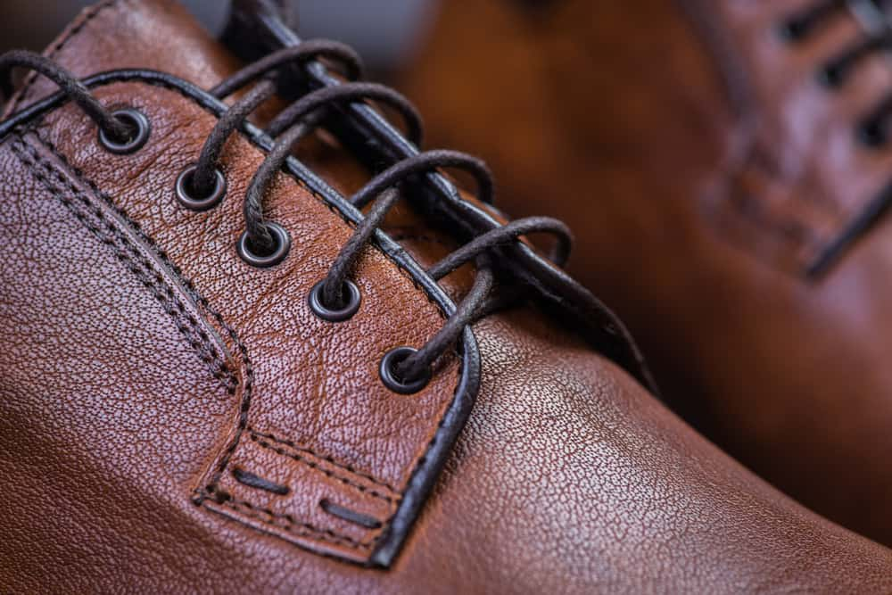 This is a close look at a pair of brown leather shoes with tie.