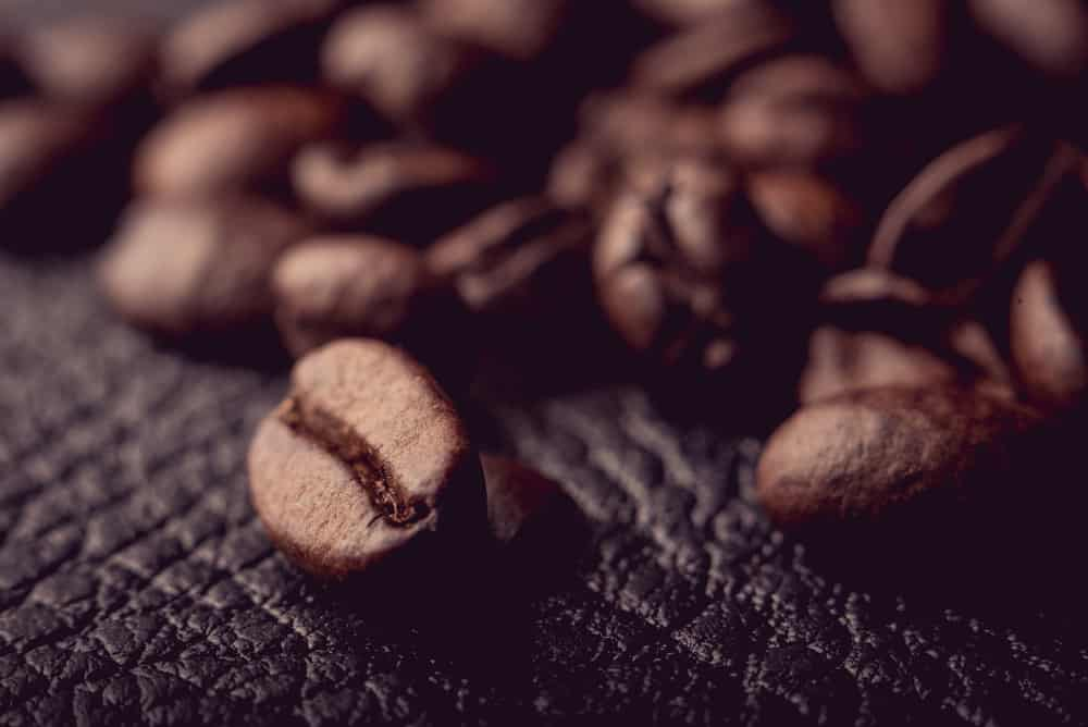These are coffee beans on a piece of leather.