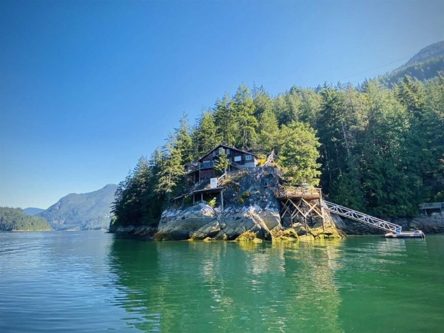 View of off grid waterfront cabin from the water