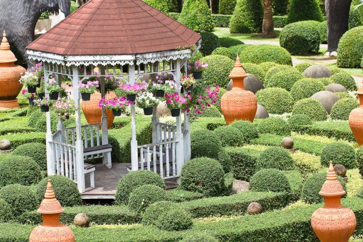 Beautifully located white and red octagon gazebo set within garden maze.