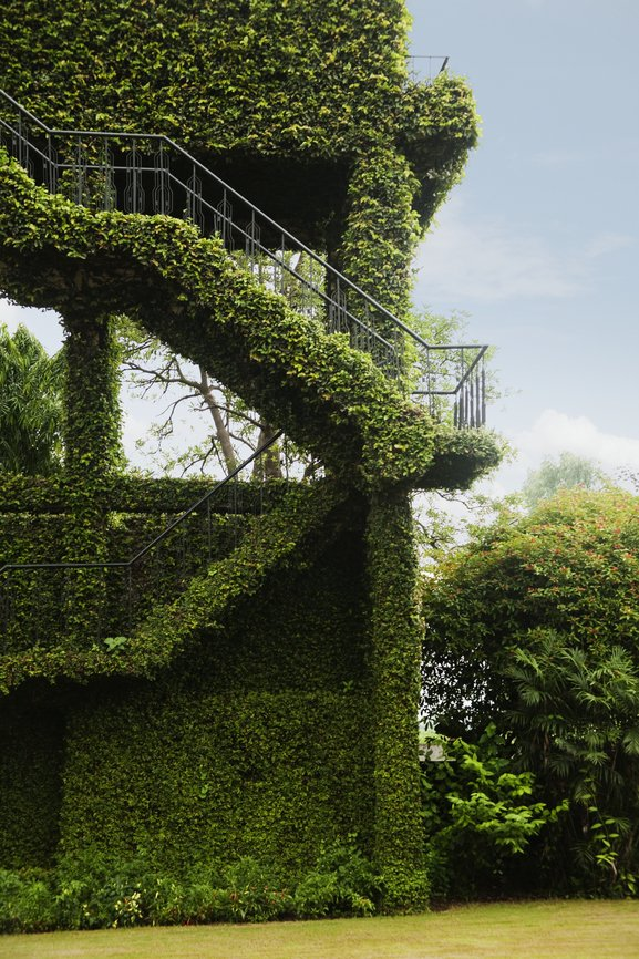 Incredible topiary sculpture of staircase and pavilion